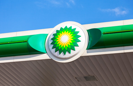 NOVGOROD REGION, RUSSIA - JULY 31, 2016: BP - British Petroleum petrol station logo against blue sky. British Petroleum is a British multinational oil and gas company