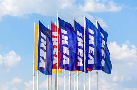 SAINT PETERSBURG, RUSSIA - JULY 28, 2016: IKEA flags against sky at the IKEA  Store. IKEA is the worlds largest furniture retailer