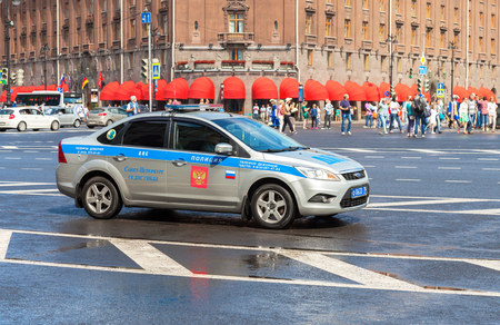 patrol car: ST. PETERSBURG, RUSSIA - JULY 31, 2016: Russian police patrol car of the State Automobile Inspectorate parked on the city street in summer day Editorial