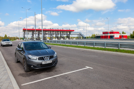 turnpike: TVER REGION, RUSSIA - JUNE 26, 2016: Charging point on the toll road. Russian highway number M11