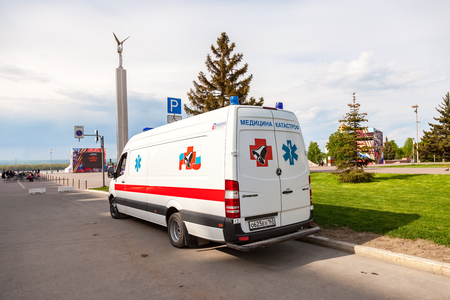 SAMARA, RUSSIA - MAY 8, 2016: Ambulance car parked up in the street. Text in russian: Emergency Medicine
