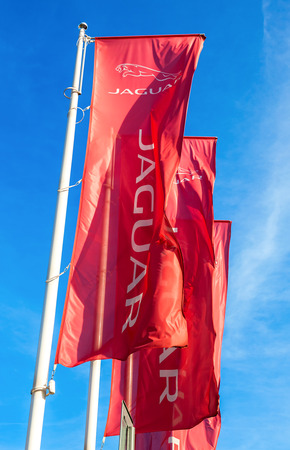 SAMARA, RUSSIA - AUGUST 27, 2016: Official dealership flags of Jaguar against the blue sky background. Brand of the British multinational car manufacturer Jaguar Land Rover, owned by Tata Motors
