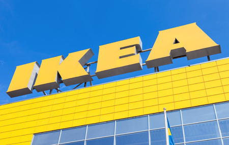 retailer: ST. PETERSBURG, RUSSIA - JULY 28, 2016: IKEA logo against blue sky. IKEA is the worlds largest furniture retailer and sells ready to assemble furniture Editorial