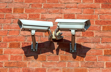 electronic survey: Surveillance cameras mounted on the wall of the building