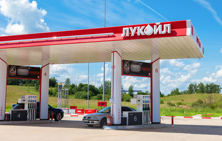 proved: BOROVICHI, RUSSIA - JUNE 26, 2016: Lukoil gas station with fueling cars. Lukoil is the largest privately owned oil and gas company in the world by proved oil reserves