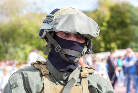 swat teams: SAMARA, RUSSIA - SEPTEMBER 11, 2016: Unidentified member of military club in camouflage army uniform and helmet during military reenacting in Samara, Russia Editorial
