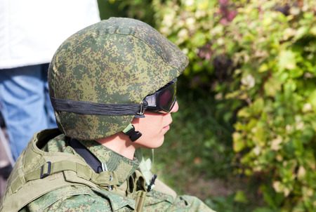 SAMARA, RUSSIA - SEPTEMBER 11, 2016: Unidentified member of military club in camouflage army uniform and helmet during military reenacting in Samara, Russia Editorial