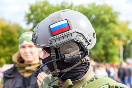 reenacting: SAMARA, RUSSIA - SEPTEMBER 11, 2016: Unidentified member of military club in camouflage army uniform and helmet during military reenacting in Samara, Russia Editorial