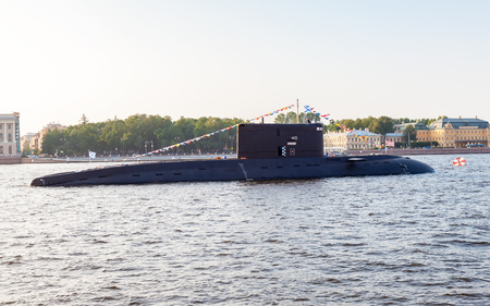ST. PETERSBURG, RUSSIA - JULY 31, 2016:  A submarine Krasnodar moored against Admiralty embankment at the Russian Navy Day