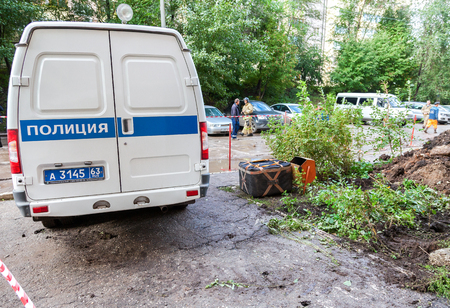 localization: SAMARA, RUSSIA - SEPTEMBER 22, 2016: Russian police vehicle and explosion localizer Fountain lies on explosive object