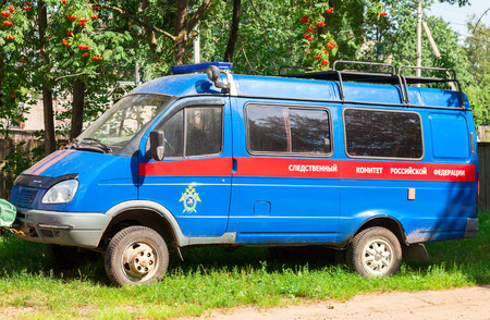 investigative: NOVGOROD, RUSSIA - AUGUST 6, 2016: The car of the Investigative Committee of the Russian Federation parked under the tree in summer day Editorial