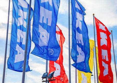 self assembly: SAMARA, RUSSIA - SEPTEMBER 25, 2016: IKEA flags against a blue sky near the IKEA Samara Store. IKEA is the worlds largest furniture retailer Editorial