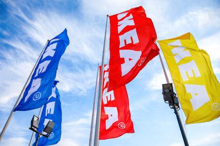 SAMARA, RUSSIA - SEPTEMBER 25, 2016: IKEA flags against a blue sky near the IKEA Samara Store. IKEA is the worlds largest furniture retailer Editorial