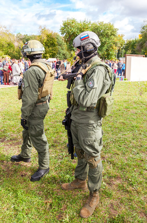 reenacting: SAMARA, RUSSIA - SEPTEMBER 11, 2016: Unidentified members of military club in camouflage army uniform and helmet (full gear) during military reenacting in Samara, Russia Editorial