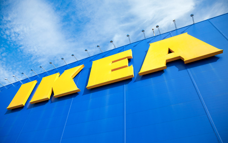 retailer: SAMARA, RUSSIA - SEPTEMBER 25, 2016: IKEA logo against a blue sky. Ikea is the worlds largest furniture retailer