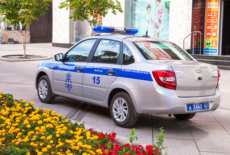 police unit: SAMARA, RUSSIA - SEPTEMBER 7, 2016: Russian police patrol vehicle parked on the city street in summer day