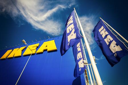 SAMARA, RUSSIA - SEPTEMBER 9, 2015: IKEA flags against sky at the IKEA Samara Store. IKEA is the world's largest furniture retailer