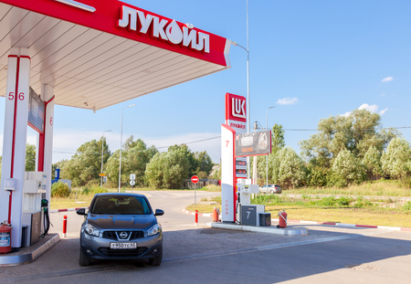 proved: BOROVICHI, RUSSIA - AUGUST 6, 2016: Car Nissan Qashqai at the Lukoil gas station. Lukoil is the largest privately owned oil and gas company in the world by proved oil reserves