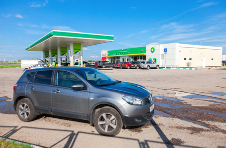 NOVGOROD REGION, RUSSIA - JULY 31, 2016: Car Nissan Qashqai on the background of BP petrol station. British Petroleum is a British multinational oil and gas company
