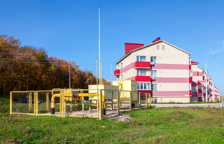 gas distribution: SAMARA, RUSSIA - OCTOBER 9, 2016: Gas regulatory and distribution point near the apartment house. Text on russian: Flammable, gas