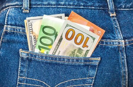 american currency: Euro and american currency, money in jeans pocket for travel and shopping