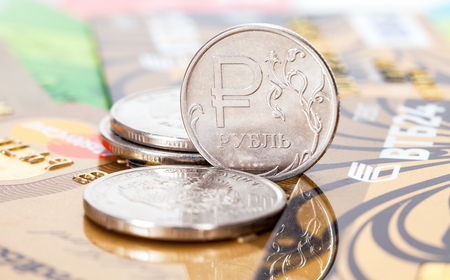 Russian rubles coins over different credit cards close up
