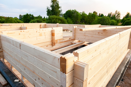 footing: Construction of a new wooden house in summer day