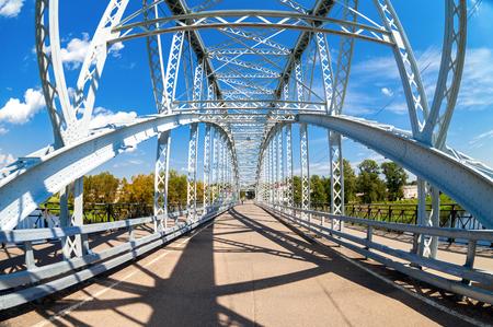 First in Russia steel arch bridge on river Msta in Borovichi, Russia. Historic iron bridge. Was build in 1905
