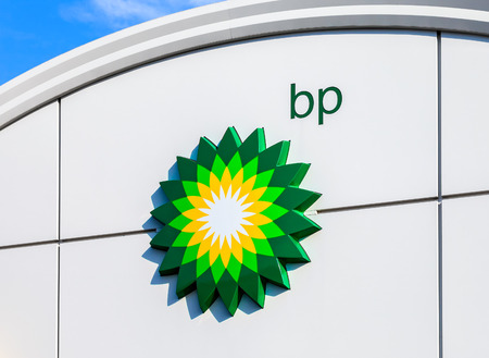 MOSCOW, RUSSIA - JULY 30, 2016: BP - British Petroleum petrol station logo over blue sky. British Petroleum is a British multinational oil and gas company
