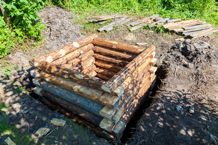 Construction new wooden water well in russian village in summertime Stock Photo