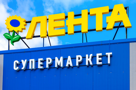 SAINT PETERSBURG, RUSSIA - JULY 27, 2016: Emblem of the supermarket Lenta against the blue sky. Lenta is one of the largest retail chains in Russia