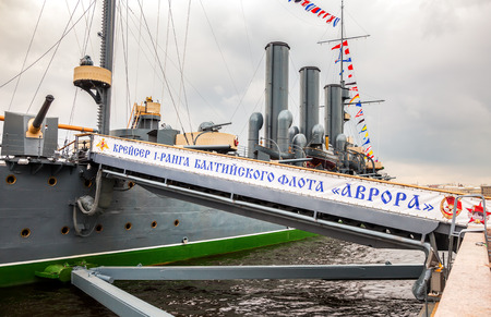 battleship: ST. PETERSBURG, RUSSIA - JULY 29, 2016: The legendary revolutionary cruiser Aurora at the place of eternal parking on the Petrograd embankment in summer day