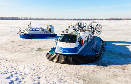 hovercraft: SAMARA, RUSSIA - MARCH 11, 2017: Passenger Hovercrafts on the ice of the frozen Volga river in Samara, Russia Editorial