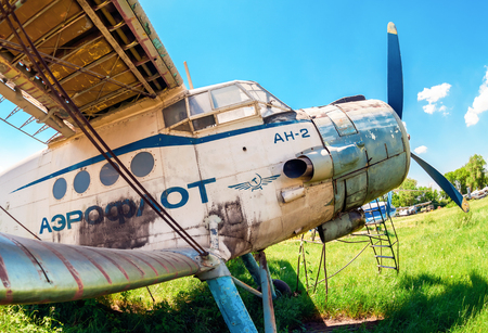SAMARA, RUSSIA - MAY 25, 2014: Old russian aircraft An-2 at an abandoned aerodrome in summertime. The Antonov An-2 is a Soviet mass-produced single-engine biplane