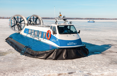 hovercraft: SAMARA, RUSSIA - MARCH 11, 2017: Passenger Hovercrafts Neptune-7 and Hivus-4 on the ice of the frozen Volga river in Samara, Russia