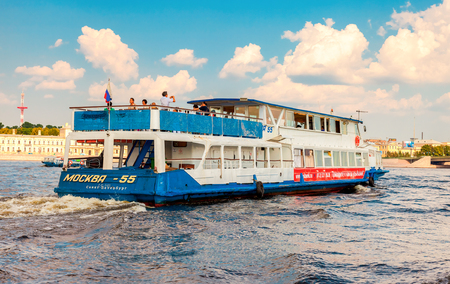 SAINT PETERSBURG, RUSSIA - AUGUST 7, 2014: River cruise ship sailing on the river Neva in summer sunny day Editorial