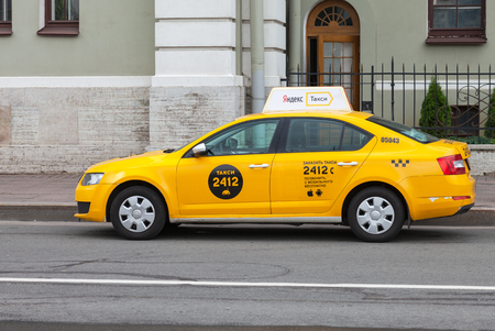 ST. PETERSBURG, RUSSIA - JULY 29, 2016: Yandex taxi at the city street in St. Petersburg, Russia Editöryel