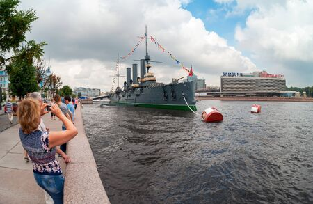 battleship: ST. PETERSBURG, RUSSIA - JULY 29, 2016: The legendary revolutionary cruiser Aurora at the place of eternal parking at Neva river in St. Petersburg, Russia