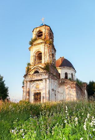 Old abandoned orthodox church in the sunset light in Novgorod region, Russia