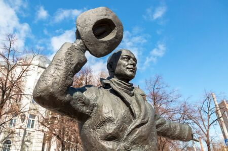 SAMARA, RUSSIA - MARCH 25, 2017: Bronze monument of Yuriy Detochkin, the protagonist of the Soviet film comedy Beware of a Car in sunny day. Fragment Editorial