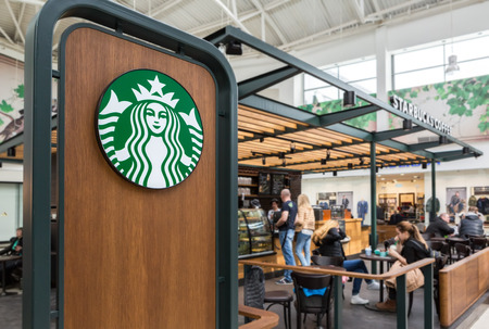 shopwindow: Samara, Russia - April 1, 2017: Starbucks cafe interior in Samara shopping center Kosmoport. Starbucks Corporation is an American global coffee company and coffeehouse chain Editorial