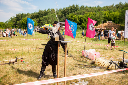 slaughter: Samara, Russia - june 18, 2016: Traditional folk competition in the cutting of the Cossack saber