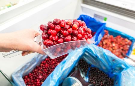 Sale of fresh frozen berries in a supermarket
