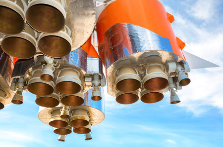 Space rocket engines of the russian spacecraft over blue sky background Stock Photo