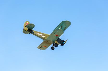 Samara, Russia - April 30, 2017: Russian retro aeroplane Polikarpov PO-2 in the blue sky