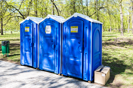 closet door: Samara, Russia - May 7, 2017: Mobile public toilets at the city park in summer sunny day