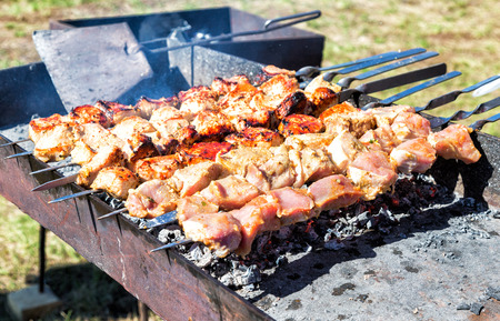 Juicy slices of meat with sauce prepare on the hot coals Stock Photo