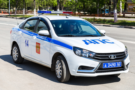 Samara, Russia - May 13, 2017: Russian police patrol car of the State Automobile Inspectorate parked on the city street in summer day