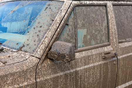 smudgy: Dirty SUV after driving in the rain on extremely dirty rural road
