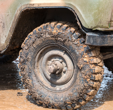smudgy: Dirty wheel of an off-road car after driving in the rain